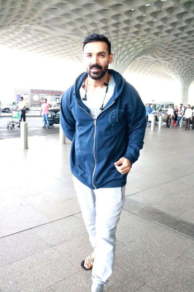 Actor John Abraham spotted at airport. - John Abraham