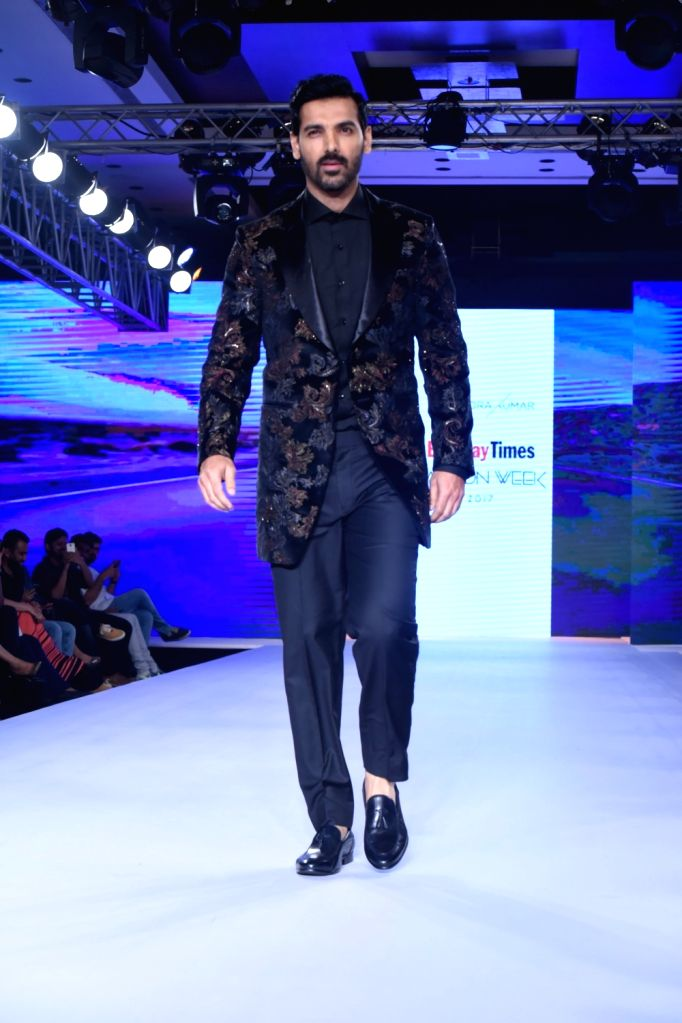 Actor John Abraham walks the ramp during the Bombay Times Fashion Week in Mumbai on Sept 9, 2017. - John Abraham