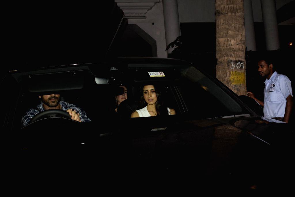 Actor John Abraham with his wife Priya Runchal seen at Mumbai's Juhu, on Feb 14, 2019. - John Abraham
