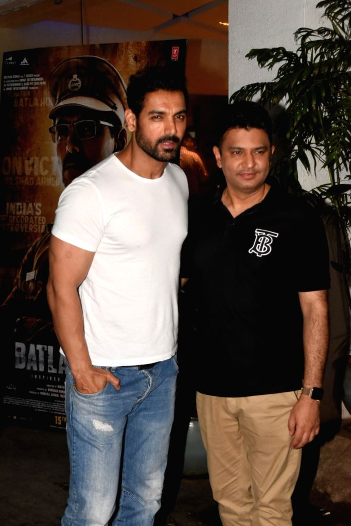 "Actor John Abraham with T-Series MD Bhushan Kumar at the screening of his upcoming film ""Batla House"" in Mumbai on Aug 13, 2019. - John Abraham and Bhushan Kumar"