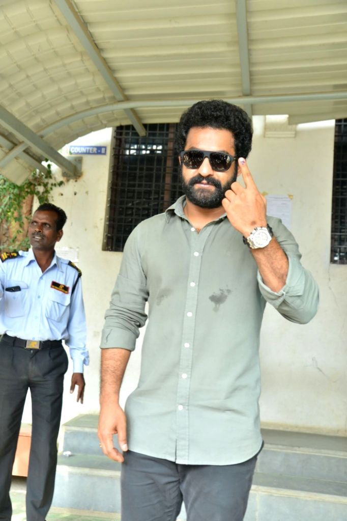 Actor Junior NTR shows his inked finger after casting his vote for Telangana Assembly elections in Hyderabad on Dec 7, 2018. - Junior N