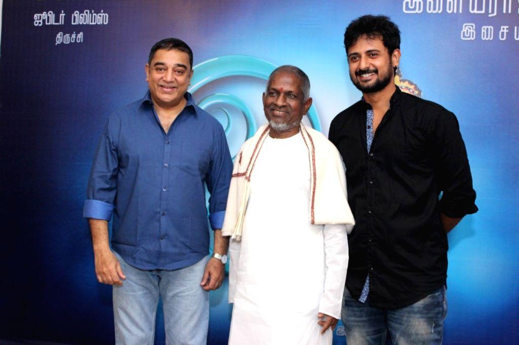 Actor Kamal Haasan and music director Ilayaraja during the audio launch of Tamil film `Oyee`. - Kamal Haasan