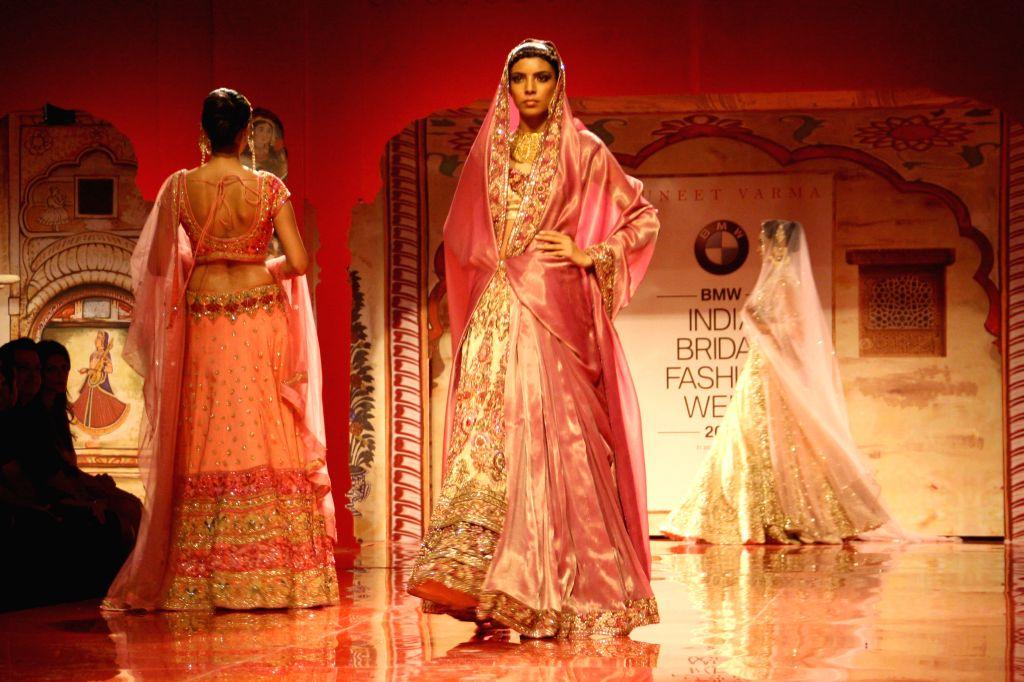 Actor Kangana Ranaut showcasing designer Suneet Verma's creation during `BMW India Bridal Fashion Week 2014`, in New Delhi on August 09,2014. - Kangana Ranaut