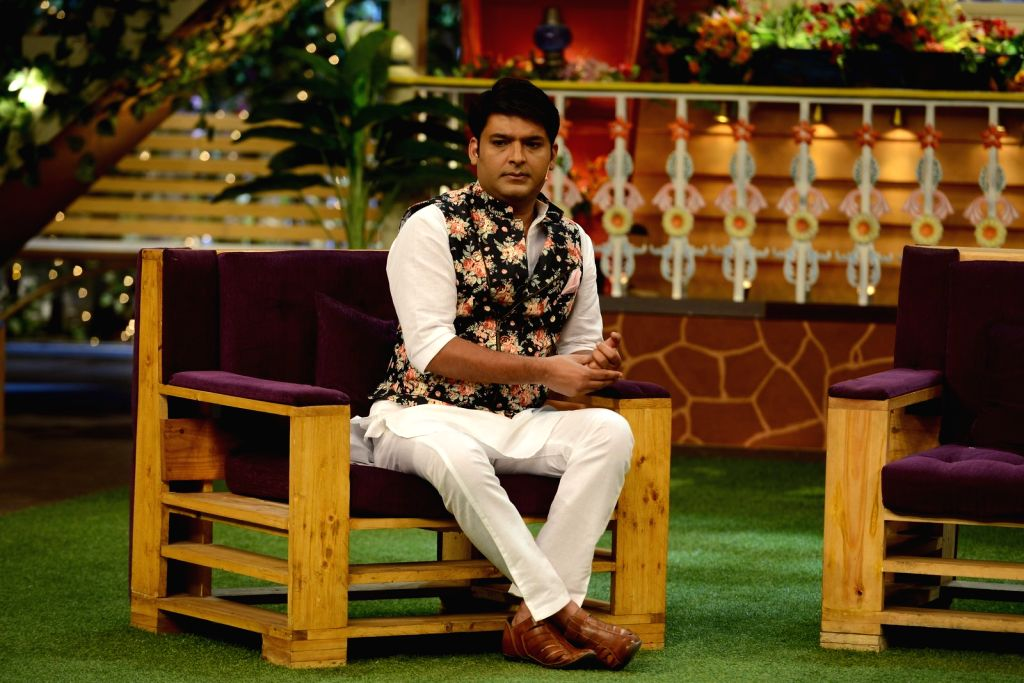 Actor Kapil Sharma during the promotion of film Anna: Kisan Baburao Hazare on the sets of The Kapil Sharma Show in Mumbai on Sept. 23, 2016. - Kapil Sharma