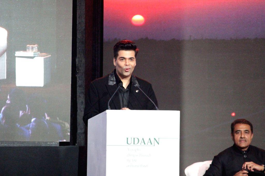 Actor Karan Johar during the launch of Nationalist Congress Party (NCP) leader Praful Patel's pictorial biography Udaan in Mumbai on May 14, 2017. - Karan Johar and Praful Patel