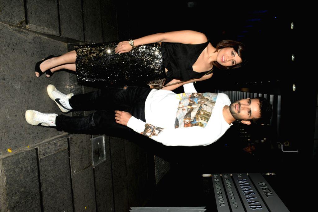 Actor Karan Tacker's parents Veena Tacker and Kuku Tacker during their son's birthday celebrations at a restaurant in Mumbai's Bandra on May 10, 2019. - Karan Tacke