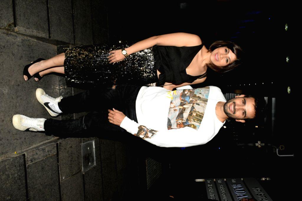 Actor Karan Tacker with his sister Sasha Tacker during his birthday celebrations at a restaurant in Mumbai's Bandra on May 10, 2019. - Karan Tacker