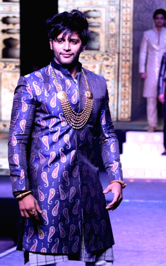 Actor Karanvir Bohra walks the ramp during the launch of a design studio, in Bengaluru on May 26, 2018. - Karanvir Bohra