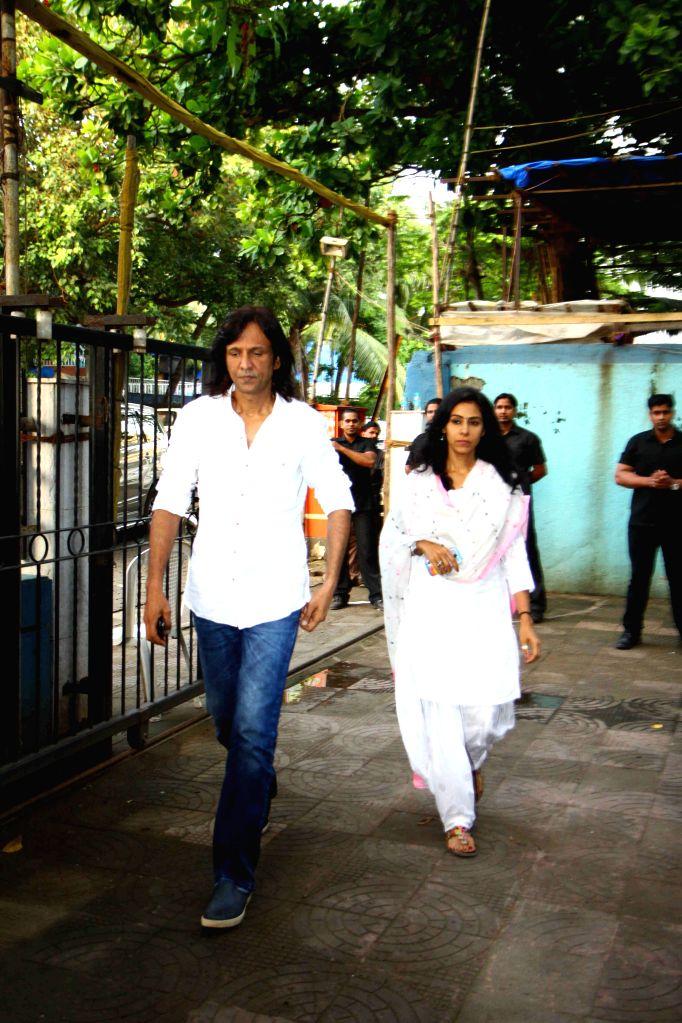 Actor Kay kay menon along with wife Nivedita during the prayer meet of Pandit Pandharinath Kolhapure, in Mumbai, on Aug 18, 2015. Pandit Pandharinath, who expired on August 15, 2015, is the ... - Kay, Shraddha Kapoor and Shivangi Kapoor