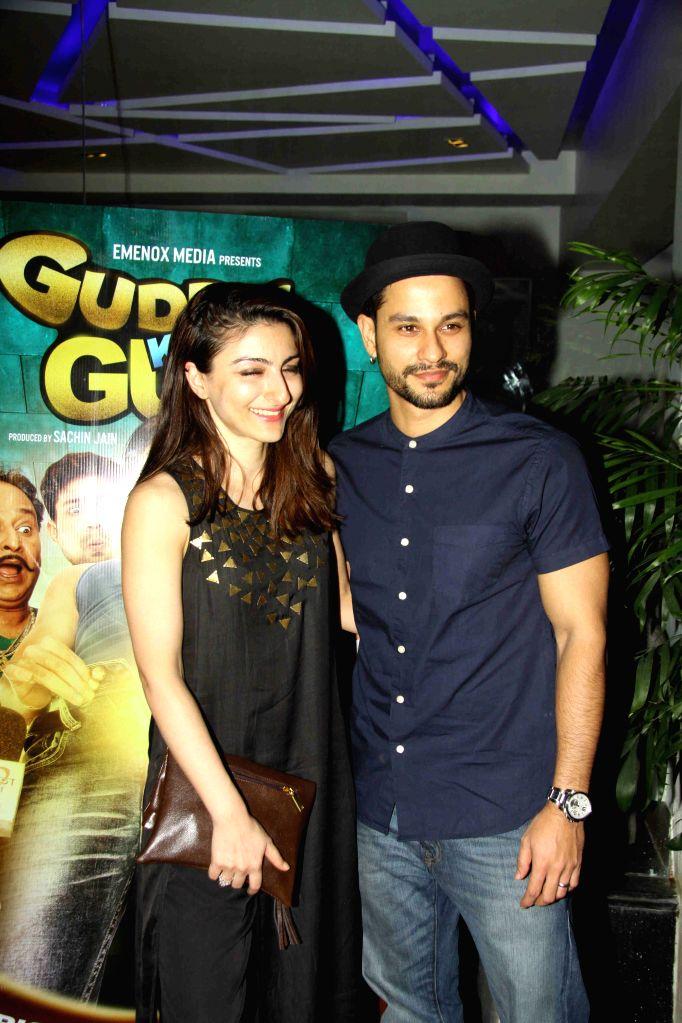Actor Kunal Khemu along with his wife and actor Soha Ali Khan during the screening of film Guddu Ki Gun in Mumbai on Oct 26, 2015. - Kunal Khemu and Soha Ali Khan