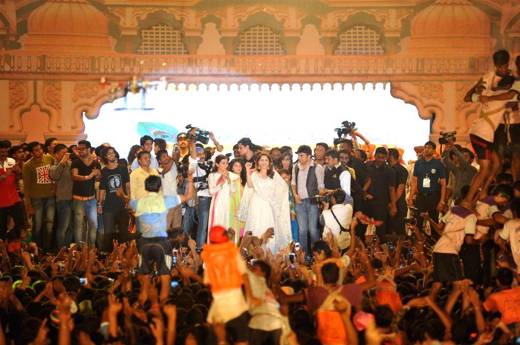Actor Madhuri Dixit during Dahi Handi 2014 celebrations organised by MNS leader Ram Kadam at Ghatkopar in Mumbai on Aug. 18, 2014. - Madhuri Dixit
