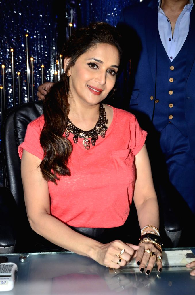Actor Madhuri Dixit on the sets of Jhalak Dikhhla Jaa 7 during the promotion of film Bobby Jasoos in Mumbai, on July 1, 2014. - Madhuri Dixit