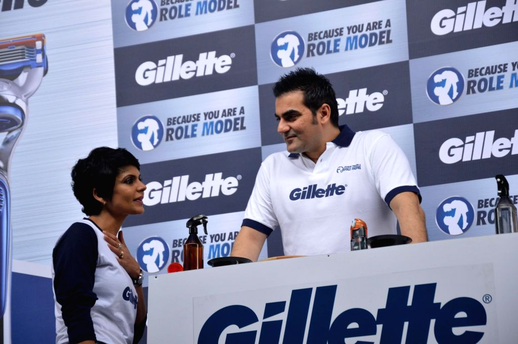 Actor Mandira Bedi and filmmaker Arbaaz Khan during an event organized to celebrate a nationwide campaign `Because You Are A Role Model` by Gillette in Mumbai on June 17th, 2014. - Mandira Bedi and Arbaaz Khan