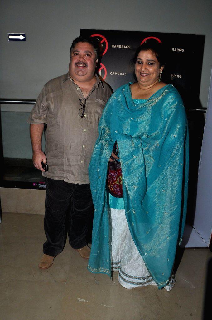 Actor Manoj Pahwa with his wife Seema Pahwa during the special screening of the film Ankhon Dekhi in Mumbai, on March 20, 2014. - Manoj Pahwa