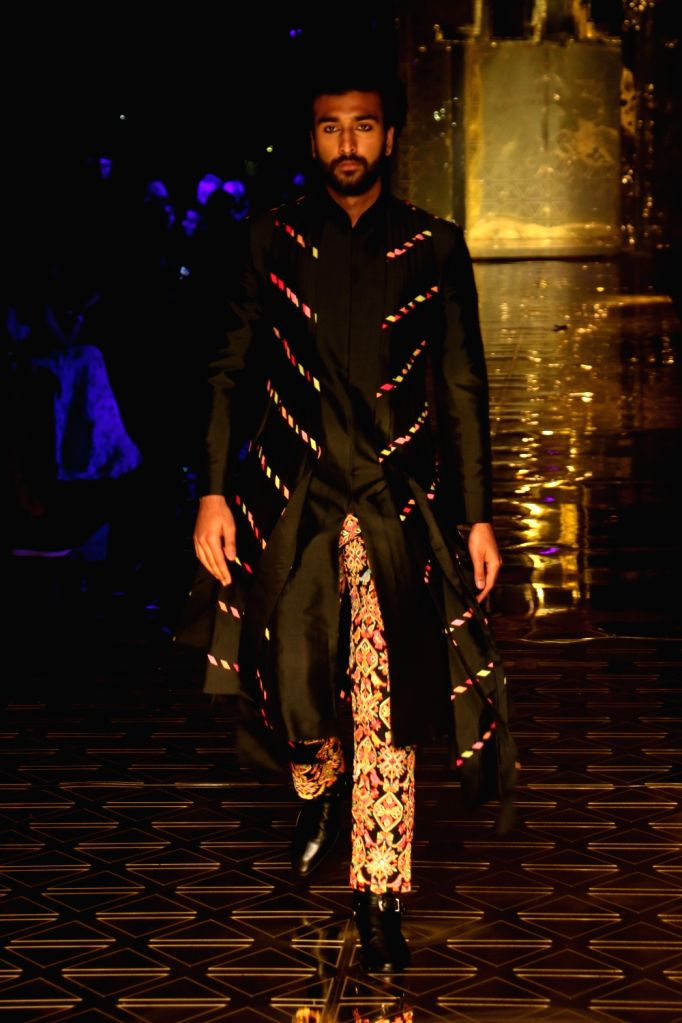 Actor Meezaan Jaffrey showcases a creation of fashion designer Abu Jani-Sandeep Khosla during a fashion show in Mumbai, on Sep 5, 2019. - Meezaan Jaffrey