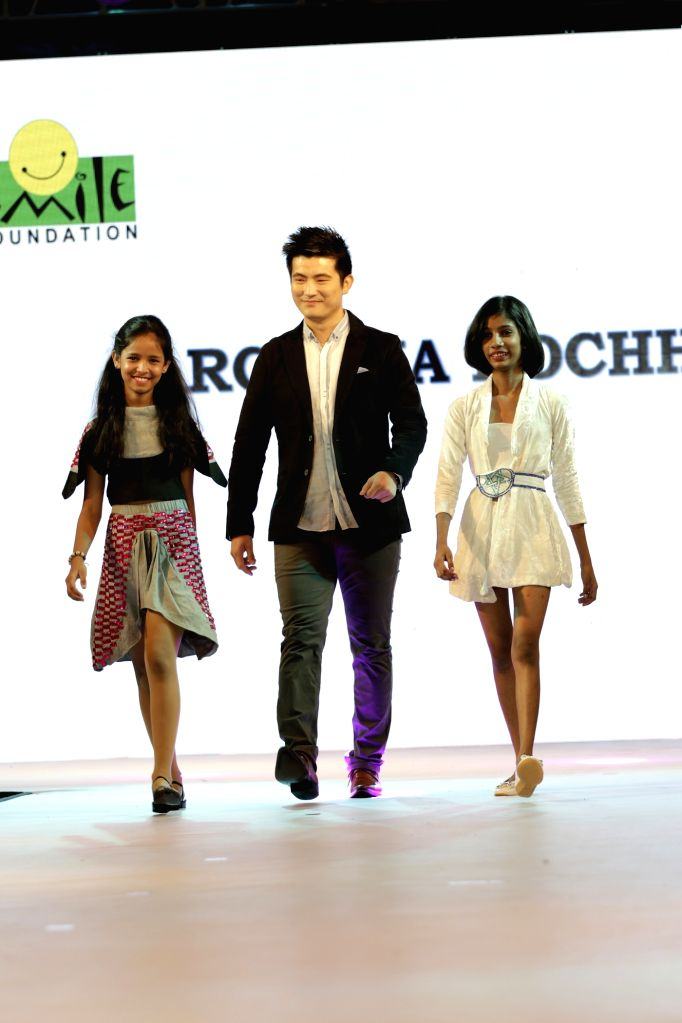 Actor Meiyang Chang walks the ramp during for 9th edition of charity fashion show organized by Smile Foundation in Mumbai, on August 2, 2015. - Meiyang Chang