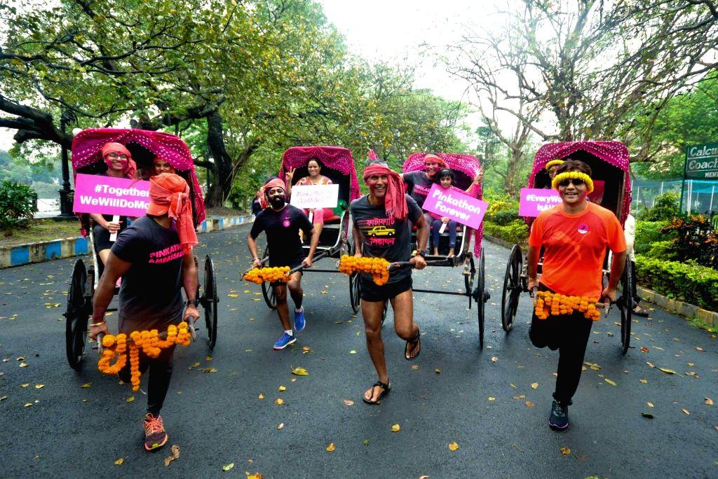 Actor Milind Soman participates during a hand-pulled rickshaws race oragnised by Pinkathon in Kolkata on March 11, 2017. - Milind Soman