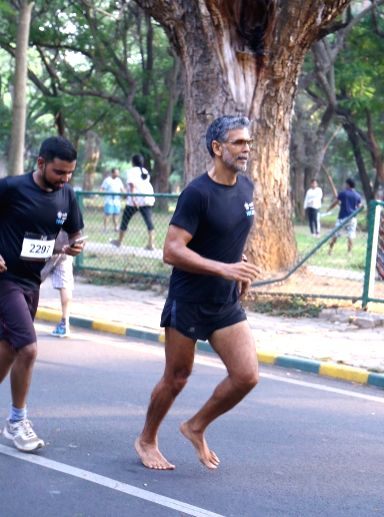 Actor Milind Soman running barefoot during Cult 10k run, in Bengaluru on May 13, 2017. - Milind Soman