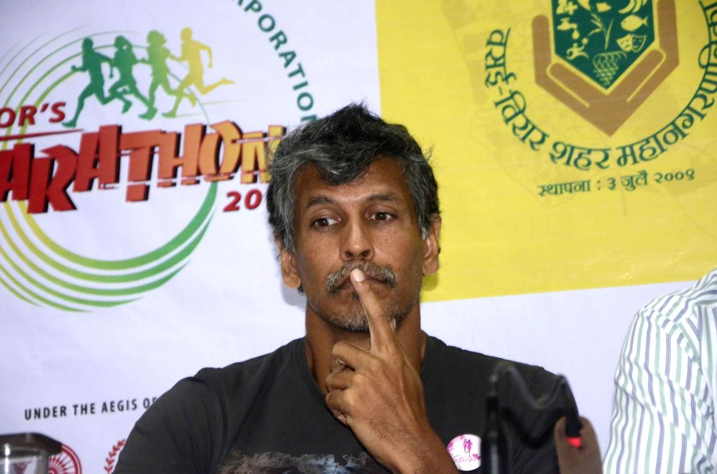 Actor-model Milind Soman during a press conference to announce 4th Vasai - Virar Mayor's Marathon at Press Club in Mumbai on Aug 27, 2014. - Milind Soman