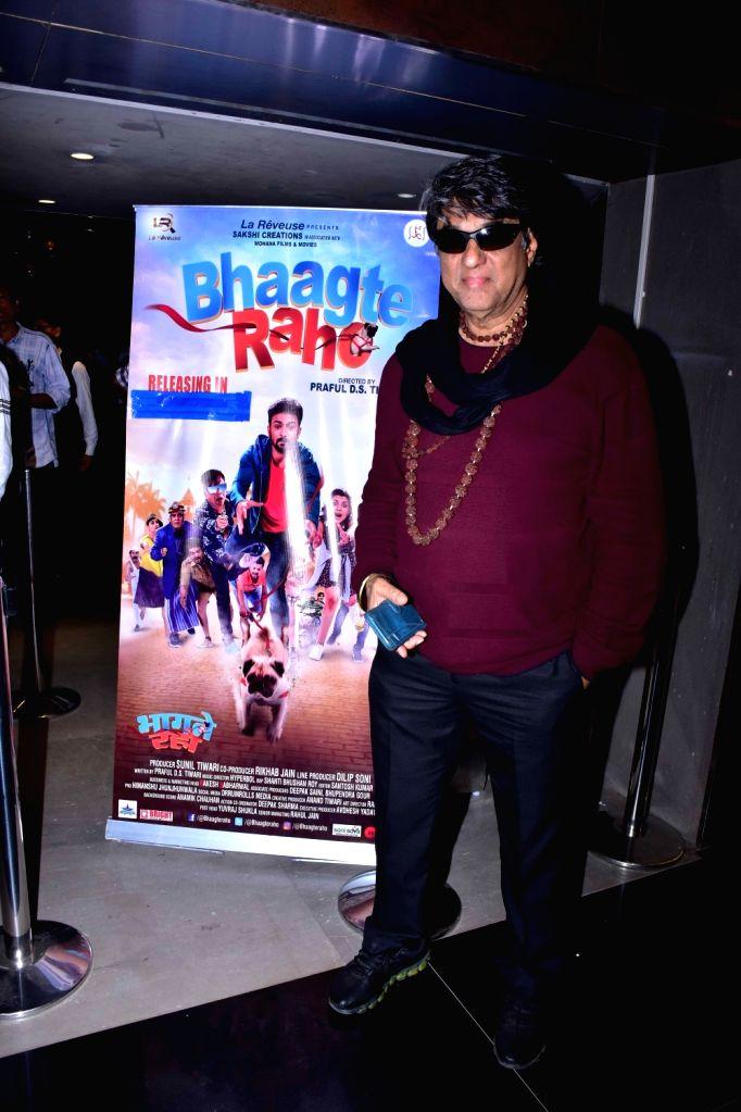 """Actor Mukesh Khanna at the screening of her upcoming film """"Bhaagte Raho"""" in Mumbai on Dec 14, 2018. - Mukesh Khanna"""