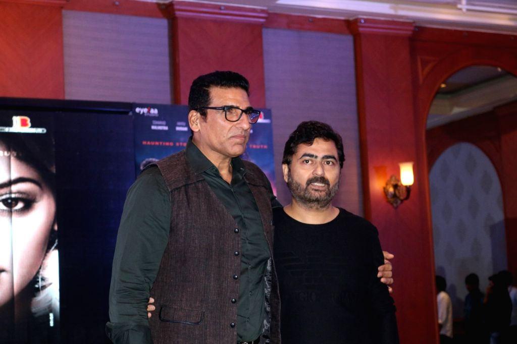 Actor Mukesh Rishi and filmmaker Arshad Siddiqui during the trailer and music launch of film 1:13:7 Ek Tera Saath in Mumbai on Sept. 16, 2016. - Mukesh Rishi