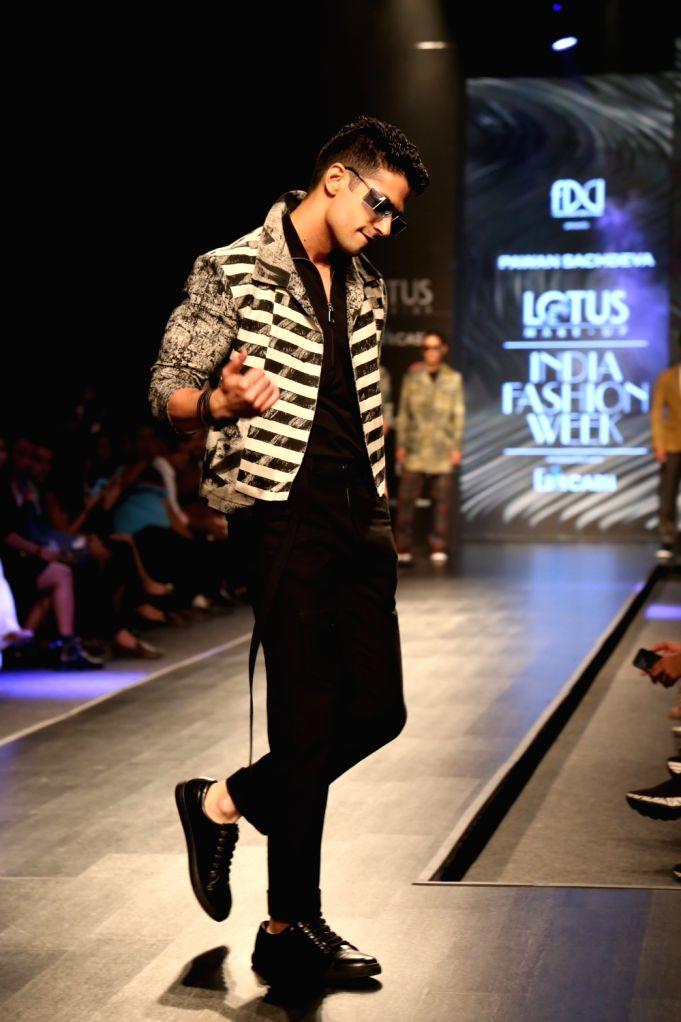 Actor Muzammil Ibrahim walks the ramp showcasing the creations of fashion designer Pawan Sachdeva on the fourth day of Lotus Make-up India Fashion Week, in New Delhi on Oct 12, 2019. - Muzammil Ibrahim