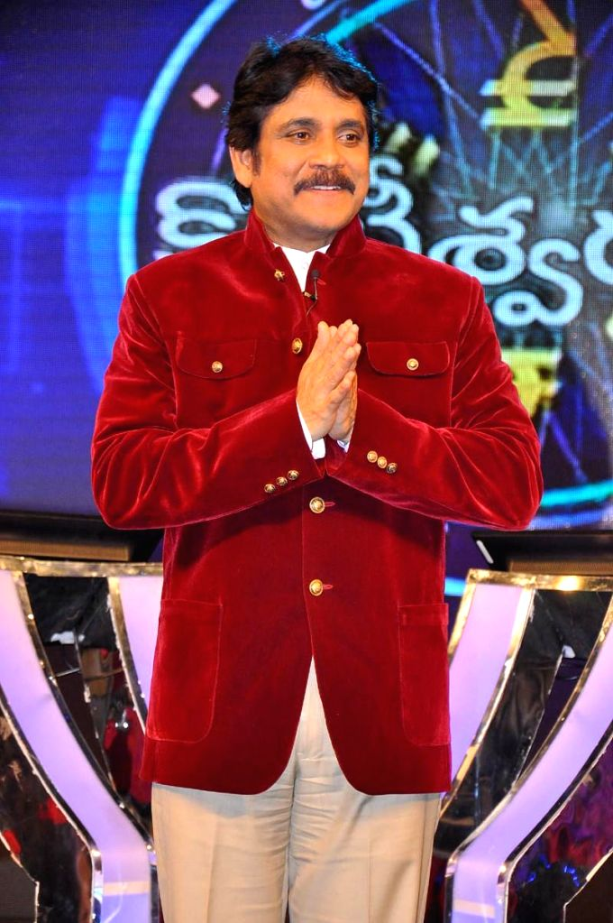 Actor Nagarjuna during the launch of 'Mee lo Evaru Kotiswarudu' a television game show which will be aired from 1st week of June, in Hyderabad on April 18, 2014. - Nagarjuna