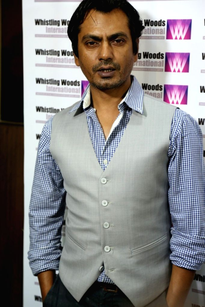 Actor Nawazuddin Siddiqui at the Whistling Woods International in Mumbai on Sept. 16, 2016, where he shared his his experience and journey secrets with WWI chief Subhash Ghai, and students of ... - Nawazuddin Siddiqui
