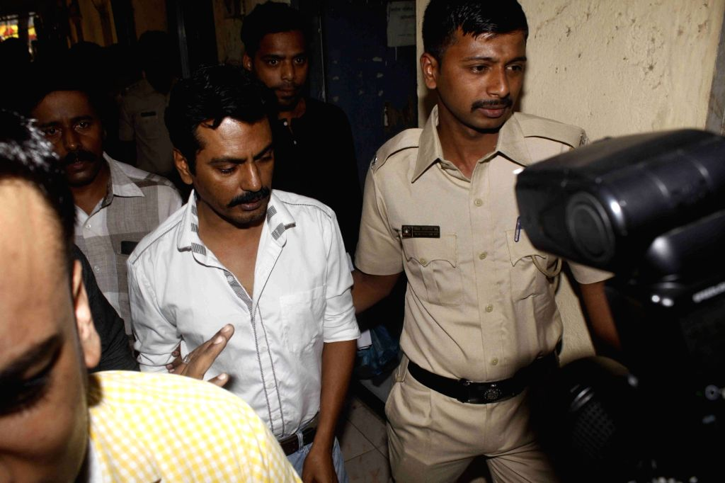 Actor Nawazuddin Siddiqui comes out of the Versova Police station in Mumbai, on January 18, 2016. An FIR was registered against the actor on Sunday for allegedly assaulting a woman over a ...