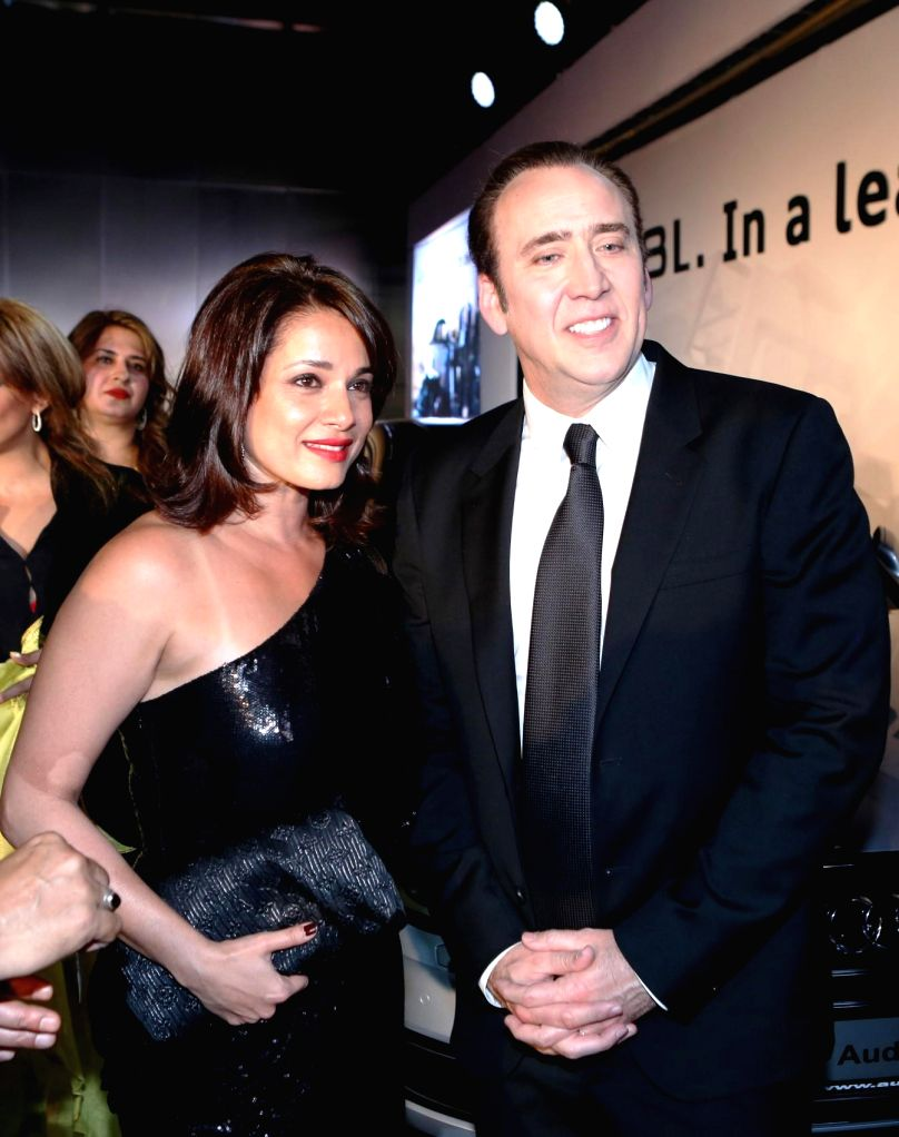 Actor Neelam Kothari and hollywood actor Nicholas Cage during the launch of Audi A8L in Dubai. - Neelam Kothari