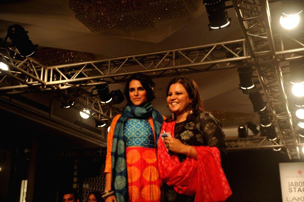 Actor Neha Dhupia displays the creation of fashion designer Swati Vijayvargie during the Lakme Fashion Week (LFW) Winter/ Festive 2014 in Mumbai, on Aug. 21, 2014. - Neha Dhupia