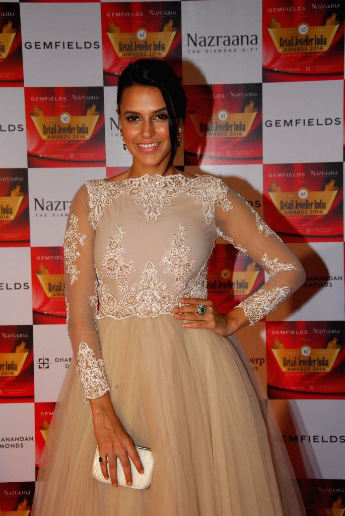 Actor Neha Dhupia during the 10th Annual Gemfields and Nazraana Retail Jeweller India Awards 2014 in Mumbai on July 19, 2014. (Photo : IANS) - Neha Dhupia