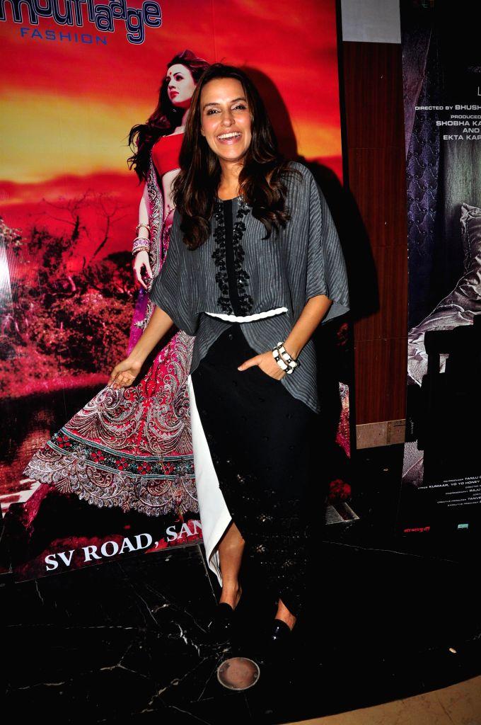 Actor Neha Dhupia during the special screening of the film Ankhon Dekhi in Mumbai, on March 20, 2014. - Neha Dhupia