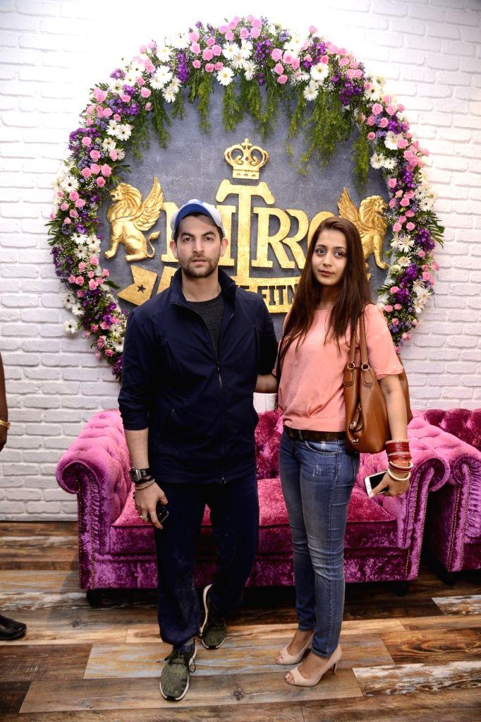 Actor Neil Nitin Mukesh along with his wife Rukmini Sahay during Praboddh Davkharey, MD, Nittro Gym birthday party celebrations, on May 29, 2017. - Neil Nitin Mukesh