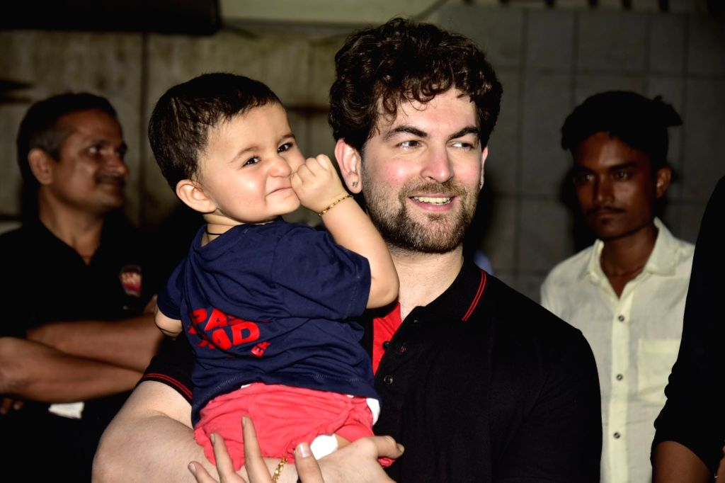 Actor Neil Nitin Mukesh with his daughter Nurvi Neil Mukesh during Ganesh idol immersion, in Mumbai on Sep 12, 2019. - Neil Nitin Mukesh