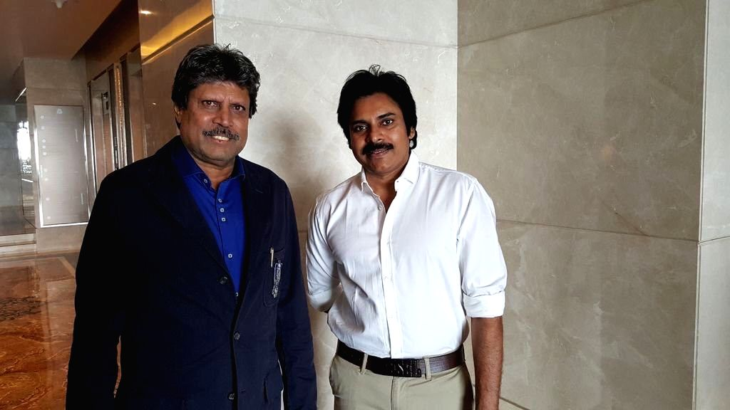 Actor Pawan Kalyan meets cricketer Kapil Dev.