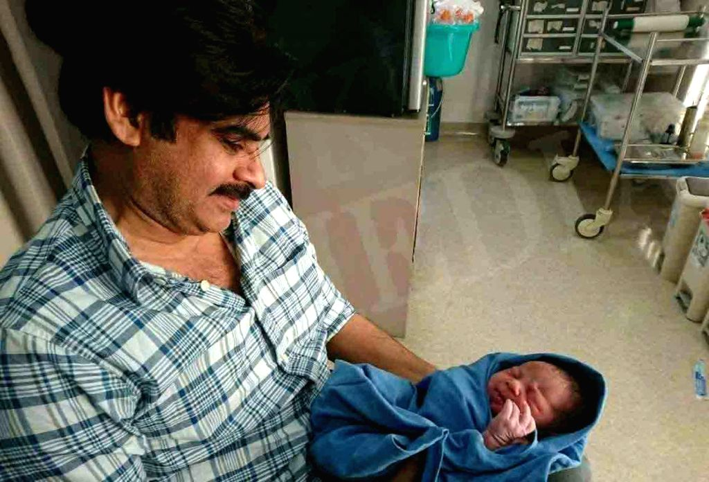 Actor Pawan Kalyan with his newborn child in Hyderabad on Oct 10, 2017. - Pawan Kalyan