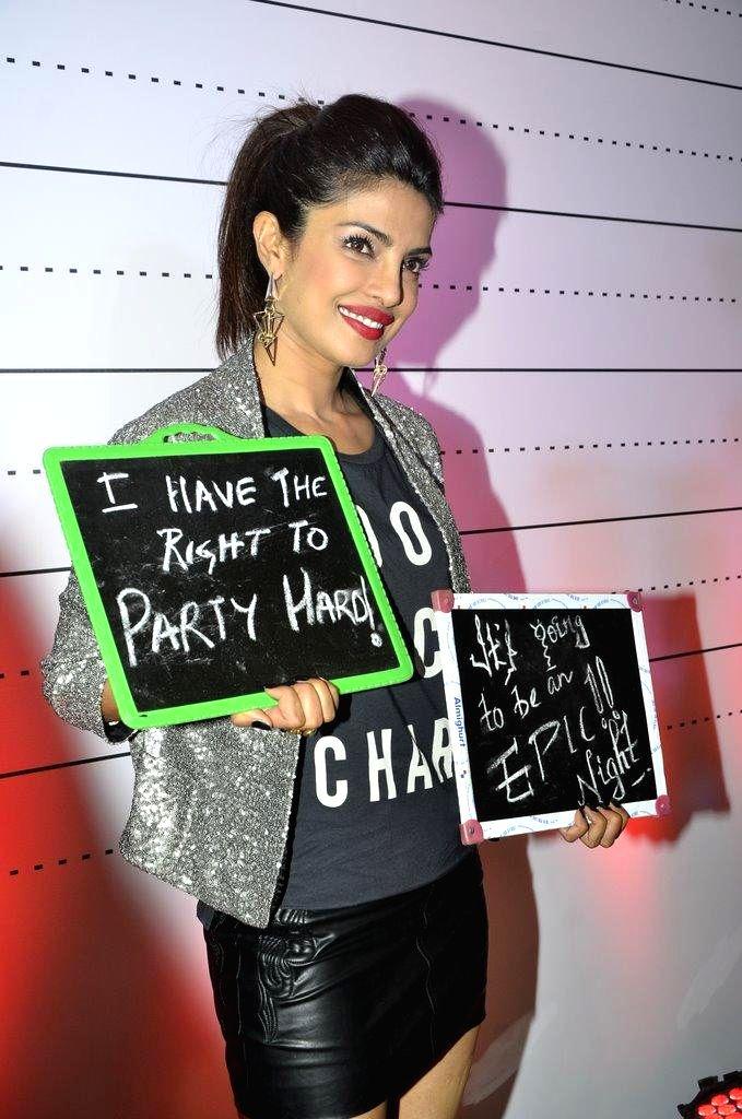 Actor Priyanka Chopra after launching her brother Siddharth Chopra's pub-lounge entitled Mugshot Lounge, in Pune on Sept 7, 2014. - Siddharth Chopra