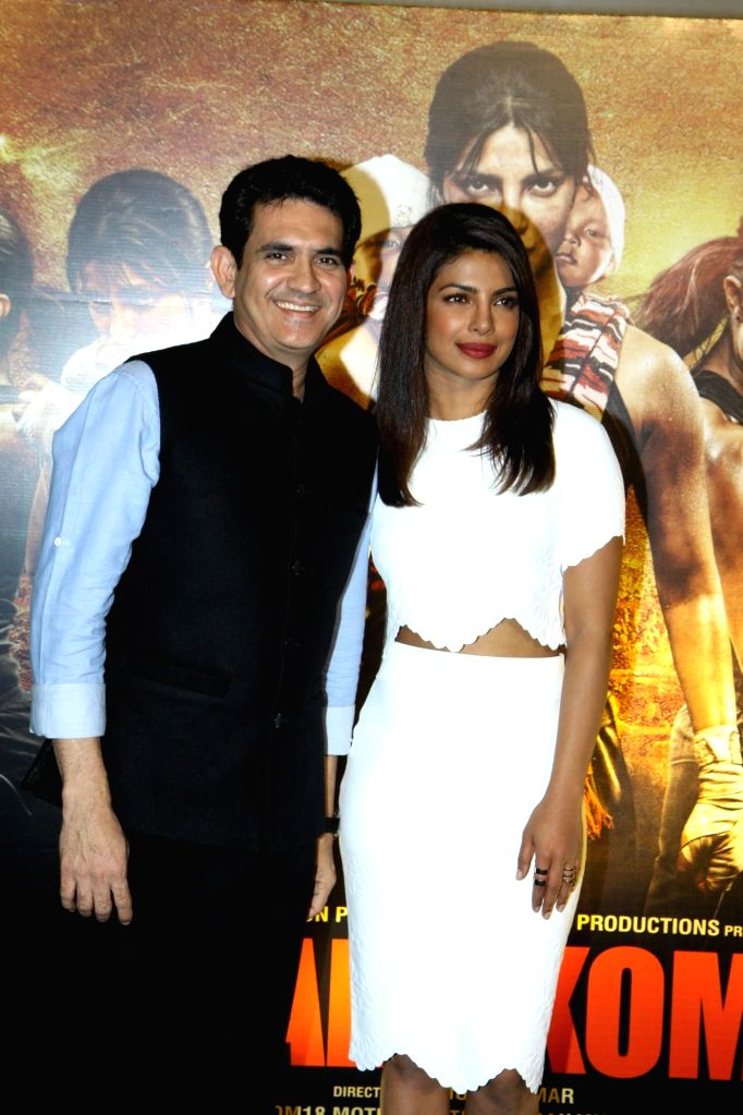 Actor Priyanka Chopra and filmmaker Omung Kumar during the unveiling of the trailer of film Mary Kom in Mumbai on July 23, 2014. - Priyanka Chopra and Omung Kumar