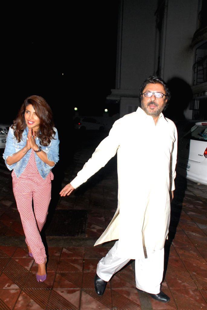 Actor Priyanka Chopra and filmmaker Sanjay Leela Bansali during her birthday celebration in Mumbai on July 25, 2014. - Priyanka Chopra