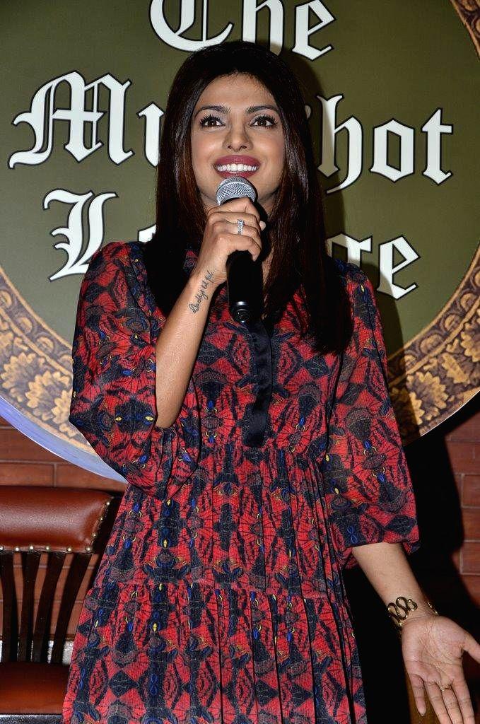 Actor Priyanka Chopra during the launch of her brother Siddharth Chopra`s pub-lounge entitled Mugshot Lounge, in Pune on Sept 7, 2014. - Siddharth Chopra