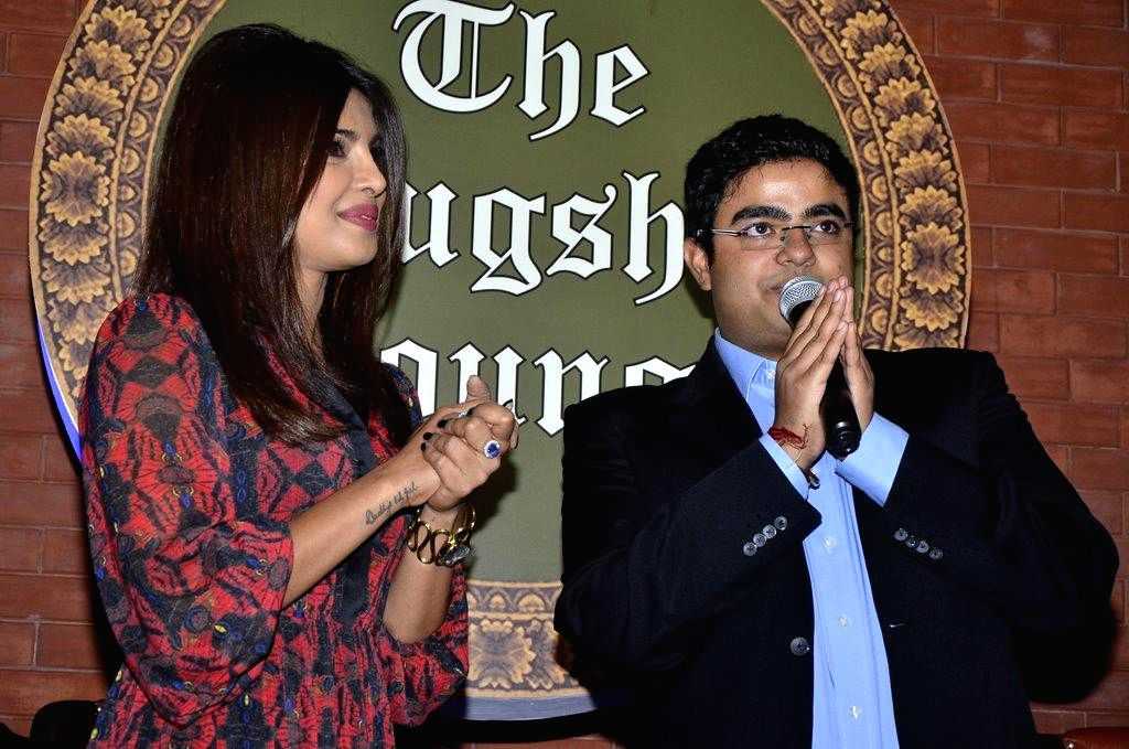Actor Priyanka Chopra with her brother Siddharth Chopra during the launch of his pub-lounge entitled Mugshot Lounge, in Pune on Sept 7, 2014. - Siddharth Chopra