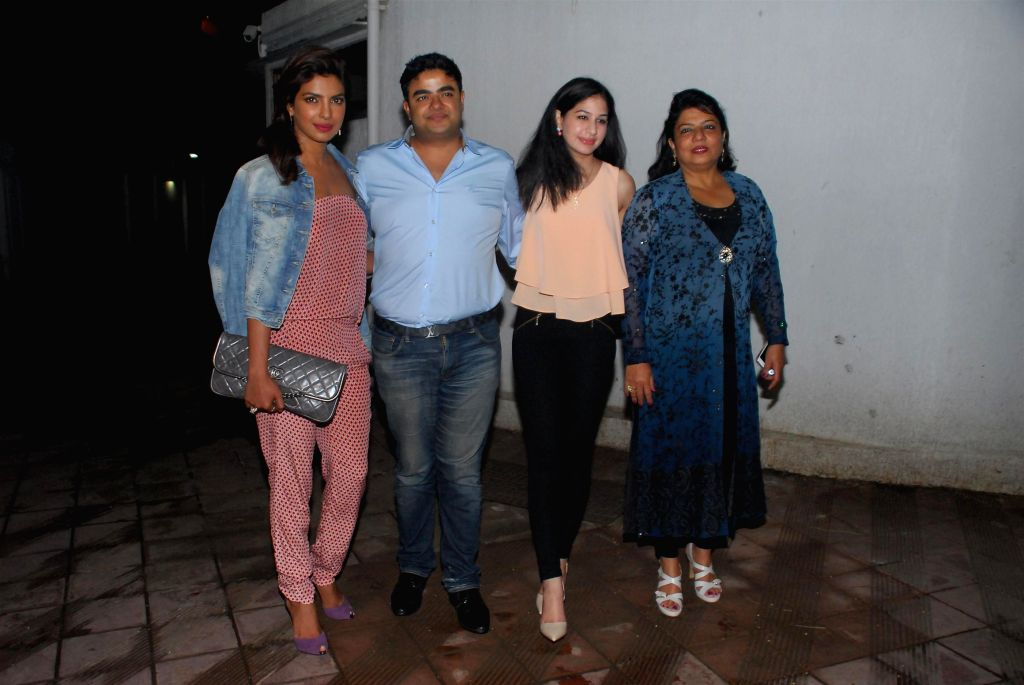 Actor Priyanka Chopra with her family during her birthday celebration in Mumbai on July 25, 2014. - Priyanka Chopra