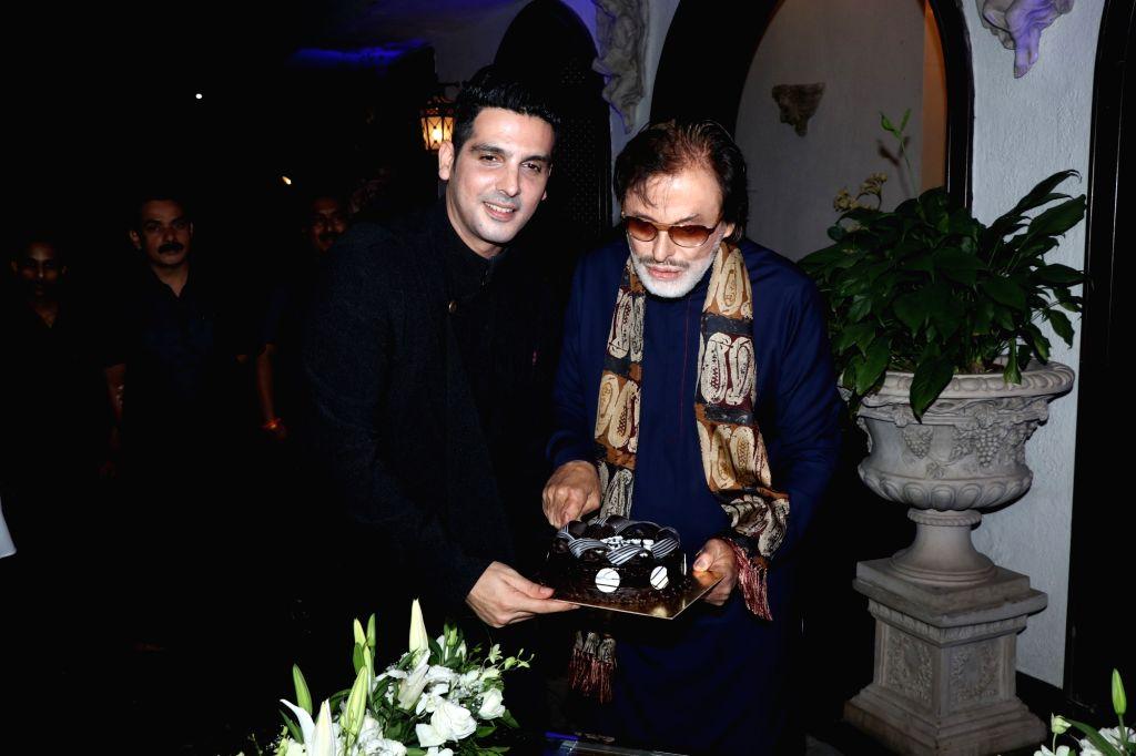 Actor-producer Sanjay Khan and son Zayed Khan at his birthday celebrations in Mumbai on Jan 3, 2019. - Sanjay Khan and Zayed Khan
