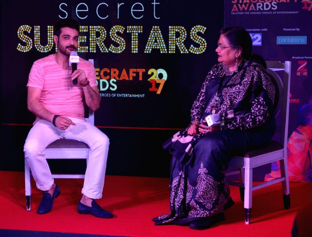 Actor Prosenjit Chatterjee and singer Usha Uthup address a press conference regarding the 4th Edition of Stagecraft Awards, 2017 in Kolkata on Oct 4, 2017. - Prosenjit Chatterjee