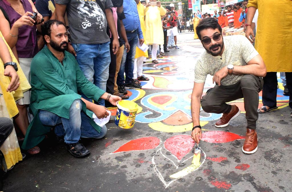 "Actor Prosenjit Chatterjee paint a street, a religio-cultural art known as ""alpona"" - in a bid to create the longest street art ahead of Durga Puja, Bengal's biggest carnival, next ... - Prosenjit Chatterjee"