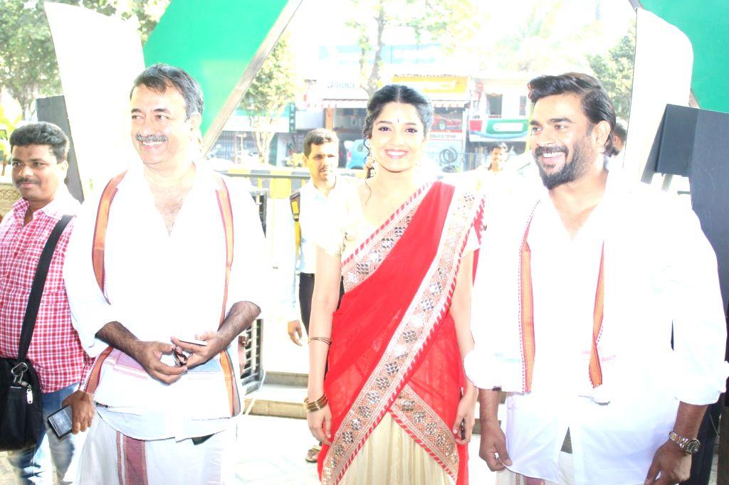 Actor R Madhavan celebrate Pongal with his upcoming film Saala Khadoos team Rajkumar Hirani and Ritika Singh in Mumbai, on Jan 14, 2016. The movie Saala Khadoos releases on 29th of this ...