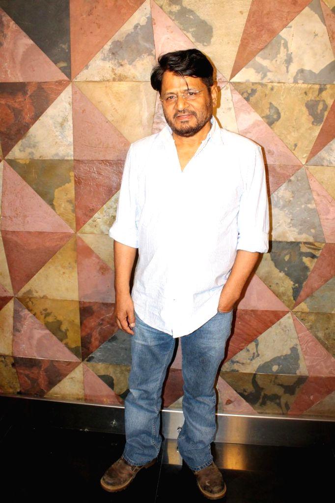 Actor Raghubir Yadav during the audience interaction of film Mantostaan in Mumbai on May 5, 2017. - Raghubir Yadav