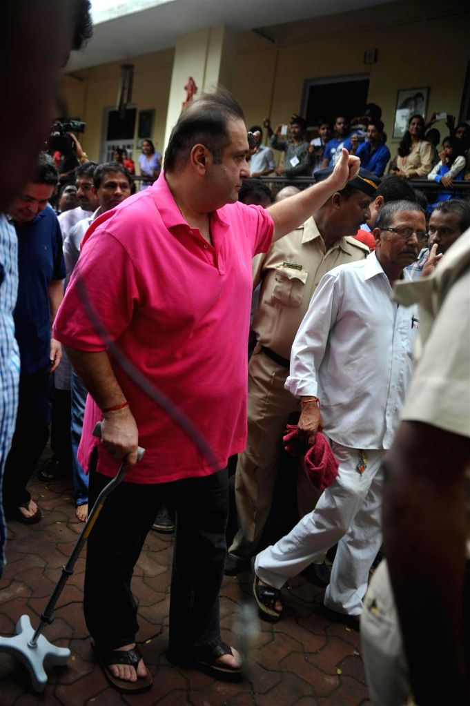 Actor Rajeev Kapoor participates during the procession on the last day of Ganesh Chaturti festival in Mumbai on September 8, 2014. - Rajeev Kapoor
