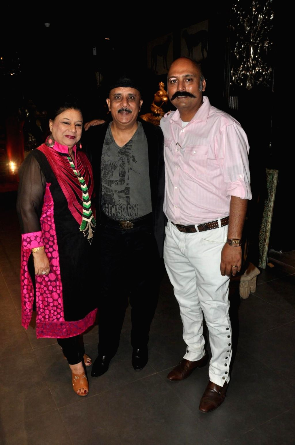 Actor Rajesh Puri along with his wife during the launch of store Grand Trunk Show in Mumbai, on April 18, 2014. - Rajesh Puri